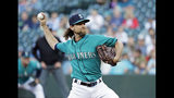 Seattle Mariners starting pitcher Mike Leake throws against the Los Angeles Angels during the first inning of a baseball game, Friday, July 19, 2019, in Seattle. (AP Photo/Ted S. Warren)