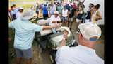 Fans surround John Daly near the 18th green during the PGA Barbasol Championship second round at Keene Trace Golf Club Champions Course in Nicholasville, Ky., Friday, July 19, 2019. (Alex Slitz/Lexington Herald-Leader via AP)