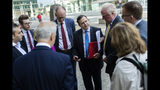 British lawmaker Alberto Costa, centre, gathers with a cross-party delegation of British parliamentarians before meeting European Union chief Brexit negotiator Michel Barnier, at the European Commission headquarters in Brussels, Friday, July 19, 2019. (AP Photo/Francisco Seco)