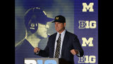 Michigan head coach Jim Harbaugh responds to a question during the Big Ten Conference NCAA college football media days Friday, July 19, 2019, in Chicago. (AP Photo/Charles Rex Arbogast)