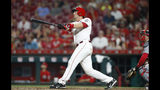 Cincinnati Reds' Ryan Lavarnway follows through on a two-run home run off St. Louis Cardinals relief pitcher Dominic Leone during the eighth inning of a baseball game Friday, July 19, 2019, in Cincinnati. (AP Photo/Gary Landers)