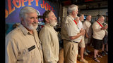 In this photo provided by the Florida Keys News Bureau, Frank Kramer, left, and other contestants try to impress the judges at the Hemingway Look-Alike Contest at Sloppy Joe's Bar Thursday, July 18, 2019, in Key West, Fla. The competition, that has attracted about 135 entrants, is part of the island city's annual Hemingway Days Festival that pays homage to Ernest Hemingway who lived and wrote in Key West in the 1930s. (Andy Newman/Florida Keys News Bureau via AP)