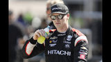 Josef Newgarden walks through the garage area following practice for the IndyCar Series auto race Friday, July 19, 2019, at Iowa Speedway in Newton, Iowa. (AP Photo/Charlie Neibergall)