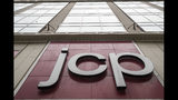 FILE - In this May 16, 2018, file photo, the J.C. Penney logo is seen hanging outside the Manhattan Mall in New York. J.C. Penney, looking to soothe rattled investors, said Friday, July 19, 2019, it hasn't hired any advisers to prepare for an in-court restructuring or bankruptcy. (AP Photo/Mary Altaffer, File)