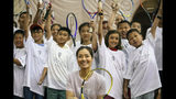 Two-time Grand Slam champion Li Na poses with students at the tennis clinic she led at the Sutton East Tennis Club Thursday, July 18, 2019, in New York. Li Na will be inducted into the Tennis Hall of Fame on Saturday, July 20. (AP Photo/Kevin Hagen)