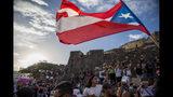 Manifestantes protestan contra el gobernador Ricardo Rosselló, en San Juan, Puerto Rico, el miércoles 17 de julio de 2019. (AP Foto/Dennis M. Rivera Pichardo)