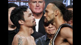 Manny Pacquiao, left, and Keith Thurman pose during a weigh-in Friday, July 19, 2019, in Las Vegas. The two are scheduled to fight in a welterweight championship boxing match Saturday in Las Vegas. (AP Photo/John Locher)
