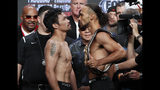 Manny Pacquiao, front left, and Keith Thurman pose during a weigh-in Friday, July 19, 2019, in Las Vegas. They are scheduled to fight in a welterweight championship boxing match Saturday in Las Vegas. (AP Photo/John Locher)
