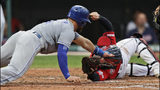 Kansas City Royals' Alex Gordon is tagged out by Cleveland Indians catcher Roberto Perez at home plate in the third inning of a baseball game, Friday, July 19, 2019, in Cleveland. (AP Photo/Tony Dejak)