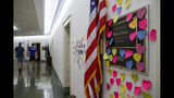 Notes line the wall outside the office of Rep. Ilhan Omar, D-Minn., Friday, July 19, 2019, part of a day-long solidarity vigil organized by anti-war protest group Code Pink, on Capitol Hill in Washington. (AP Photo/Jacquelyn Martin)