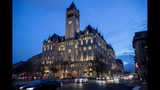 FILE - In this Jan. 23, 2019, file photo, the Trump International Hotel near sunset in Washington. The Justice Department is challenging a District of Columbia federal judge's decision allowing a case accusing President Donald Trump of profiting off the presidency to go forward. Justice lawyers want an appeals court to take the case instead. (AP Photo/Alex Brandon, file)