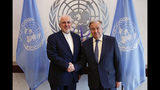 Iranian Foreign Minister Mohammad Javad Zarif, left, shakes hands with U.N. Secretary General Antonio Guterres at United Nations headquarters Thursday, July 18, 2019. (AP Photo/Frank Franklin II)