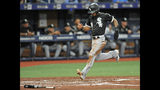 Chicago White Sox's Leury Garcia scores on Yoan Moncada's RBI-double off Tampa Bay Rays starter Brendan McKay during the second inning of a baseball game Friday, July 19, 2019, in St. Petersburg, Fla. (AP Photo/Steve Nesius)