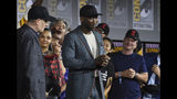 "Mahershala Ali, center, wears a hat to promote his new movie ""Blade"" at the Marvel Studios panel on day three of Comic-Con International on Saturday, July 20, 2019, in San Diego. (Photo by Chris Pizzello/Invision/AP)"