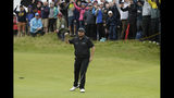 Ireland's Shane Lowry celebrates after making a birdie at the 10th hole during the second round of the British Open Golf Championships at Royal Portrush in Northern Ireland, Friday, July 19, 2019.(AP Photo/Matt Dunham)