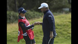 England's Lee Westwood touches fists with his caddie and girlfriend Helen Storey after getting a birdie on the 4th green during the third round of the British Open Golf Championships at Royal Portrush in Northern Ireland, Saturday, July 20, 2019.(AP Photo/Jon Super)