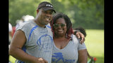 Michael and Maree Whitlow felt like they had lost of their own children when 14-year-old Jaykwon Sharp was shot and killed. He had been part of the Columbus Inspiring Children to Excellence football program that the Whitow's founded. (Doral Chenoweth III/The Columbus Dispatch via AP)