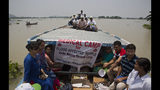 A medical team travels on a boat to attend to flood victims in Gagalmari, in the northeastern Indian state of Assam, Friday, July 19, 2019. In the Indian state of Assam, officials said floodwaters have killed more than a dozen people and brought misery to some 4.5 million. (AP Photo/Anupam Nath)