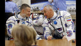 U.S. astronaut Andrew Morgan, left, and Russian cosmonaut Alexander Skvortsov speak prior to the launch of Soyuz-FG rocket at the Russian leased Baikonur cosmodrome, Kazakhstan, Saturday, July 20, 2019. (AP Photo/Dmitri Lovetsky)