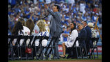 """Former Los Angeles Dodgers pitcher Fernando Valenzuela waves to fans as he is inducted into the """"Legends of Dodger Baseball"""" prior to a baseball game against the Miami Marlins Saturday, July 20, 2019, in Los Angeles. (AP Photo/Mark J. Terrill)"""