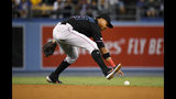 Miami Marlins second baseman Starlin Castro reaches for a ball hit by Los Angeles Dodgers' Enrique Hernandez after bobbling it during the sixth inning of a baseball game Friday, July 19, 2019, in Los Angeles. Hernandez was safe at first, Justin Turner scored and Castro was charged with an error on the play. (AP Photo/Mark J. Terrill)