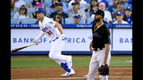 Los Angeles Dodgers' Joc Pederson, left, heads to first after hitting a solo home run as Miami Marlins starting pitcher Sandy Alcantara watches during the first inning of a baseball game Saturday, July 20, 2019, in Los Angeles. (AP Photo/Mark J. Terrill)