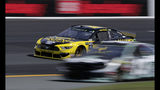 Pole sitter Brad Keselowski (2) passes slower cars during a NASCAR Cup Series auto race practice at New Hampshire Motor Speedway in Loudon, N.H., Saturday, July 20, 2019. (AP Photo/Charles Krupa)