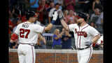 Atlanta Braves' Brian McCann, right, celebrates with Austin Riley (27) after hitting a two-run home run in the sixth inning of a baseball game against the Washington Nationals Saturday, July 20, 2019, in Atlanta. (AP Photo/John Bazemore)