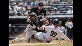 Colorado Rockies catcher Tony Wolters, left, tags out New York Yankees' Aaron Judge, right, during the first inning of a baseball game as home plate umpire Chris Conroy watches Saturday, July 20, 2019, in New York. (AP Photo/Frank Franklin II)
