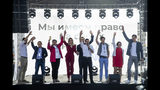 Russian opposition candidate and lawyer at the Foundation for Fighting Corruption Lyubov Sobol, center left, and candidate Ivan Zhdanov, center right, with other candidates wave to the crowd during a protest in Moscow, Russia, Saturday, July 20, 2019. Masses of people gathered in central Moscow to demand that opposition candidates be included on ballots for an upcoming city parliament election in September. (AP Photo/Pavel Golovkin)
