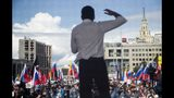 Russian opposition activist Ilya Yashin gestures while speaking to a crowd during a protest in Moscow, Russia, Saturday, July 20, 2019. Masses of people gathered in central Moscow to demand that opposition candidates be included on ballots for an upcoming city parliament election in September. (AP Photo/Pavel Golovkin)