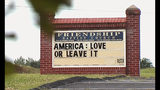 "FILE - This Tuesday, July 16, 2019 image from video provided by WSET-TV shows a sign for the Friendship Baptist Church which reads, ""America: Love it or Leave It"" in Appomattox, Va. Amid a national furor over President Donald Trump's tweet urging four Democratic congresswomen to ""go back"" to their home countries, Pastor E. W. Lucas is gaining attention with the sign at his church. (WSET-TV via AP)"