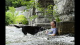 Bruce and dog Kiera cool down in the Mississippi River in Pakenham, Ontario on Friday, July 19, 2019, as a heat wave hits the National Capital region. (Sean Kilpatrick/The Canadian Press via AP)