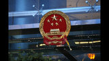 An egg thrown by a protester hits the National Emblem of the People's Republic of China at the Chinese Liaison Office in Hong Kong on Sunday, July 21, 2019. Protesters in Hong Kong pressed on Sunday past the designated end point for a march in which tens of thousands repeated demands for direct elections in the Chinese territory and an independent investigation into police tactics used in previous demonstrations. (AP Photo/Bobby Yip)