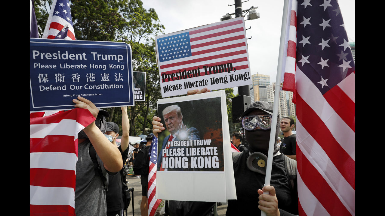 The Latest: Hong Kong protesters target Chinese emblem | FOX23