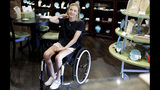 In this Monday, July 8, 2019 photo, Izzy Kitterman, 15, attends an event at The Vintage Pearl as they launch the Izzy K. Collection to help fund her rehabilitation in Tulsa, Okla. Kitterman was injured in an auto accident in 2017. Starting this fall as a sophomore at Jenks High School, she will attend classes full-time while therapists will come to her house five days a week. (Mike Simons/Tulsa World via AP)