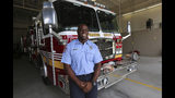 In this Wednesday, July 10, 2019 photo, firefighter Marlon Moye-Moore stands at the Orange County Fire Rescue Fire Station 81 where he works in Orlando, Fla. Moye-Moore, 39, played nine seasons with the Orlando Predators of the Arena Football League after playing football at the University of Maryland. He now serves as a firefighter in Orange County. (Ricardo Ramirez Buxeda//Orlando Sentinel via AP)