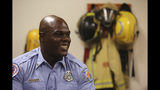 In this Wednesday, July 10, 2019 photo, Marlon Moye-Moore poses for a photo at Orange County Fire Rescue Fire Station 81, in Orlando, Fla. Moye-Moore, 39, played nine seasons with the Orlando Predators of the Arena Football League after playing football at the University of Maryland. He now serves as a firefighter in Orange County. (Ricardo Ramirez Buxeda/Orlando Sentinel via AP)