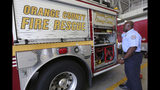In this Wednesday, July 10, 2019 photo, firefighter Marlon Moye-Moore shows Fire Engine 81 at Orange County Fire Rescue Fire Station 81, in Orlando, Fla. Moye-Moore, 39, played nine seasons with the Orlando Predators of the Arena Football League after playing football at the University of Maryland. He now serves as a firefighter in Orange County. (Ricardo Ramirez Buxeda/Orlando Sentinel via AP)
