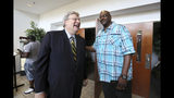 In this Saturday, July 13, 2019, photo, former University of Memphis and NBA basketball player William Bedford, right, chats with Mayor Jim Strickland after his graduation from Manhood University at New Sardis Baptist Church in Memphis, Tenn. Manhood University is the City of Memphis' program aimed at reducing recidivism and easing reentry into society. (Joe Rondone/The Commercial Appeal via AP)