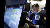 Trader Thomas Donato works on the floor of the New York Stock Exchange, Friday, July 19, 2019. U.S. stocks moved broadly higher in early trading on Wall Street Friday and chipped away at the week's losses. (AP Photo/Richard Drew)
