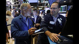 Trader Timothy Nick, left, and specialist Anthony Matesic work on the floor of the New York Stock Exchange, Friday, July 19, 2019. U.S. stocks moved broadly higher in early trading on Wall Street Friday and chipped away at the week's losses. (AP Photo/Richard Drew)