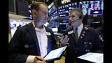 Traders Michael Smyth, left, and John Panin confer on the floor of the New York Stock Exchange, Friday, July 19, 2019. U.S. stocks moved broadly higher in early trading on Wall Street Friday and chipped away at the week's losses. (AP Photo/Richard Drew)
