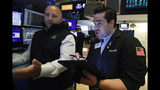 Specialist John Parisi, left, and trader Joseph Lawler work on the floor of the New York Stock Exchange, Friday, July 19, 2019. U.S. stocks moved broadly higher in early trading on Wall Street Friday and chipped away at the week's losses. (AP Photo/Richard Drew)