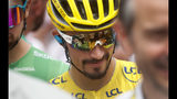 France's Julian Alaphilippe wearing the overall leader's yellow jersey arrives at the start of the fifteenth stage of the Tour de France cycling race over 185 kilometers (114,95 miles) with start in Limoux and finish in Prat d'Albis, France, Sunday, July 21, 2019. (AP Photo/Thibault Camus)