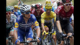 France's Julian Alaphilippe wearing the overall leader's yellow jersey rides in the pack during the fifteenth stage of the Tour de France cycling race over 185 kilometers (114,95 miles) with start in Limoux and finish in Prat d'Albis, France, Sunday, July 21, 2019. (AP Photo/Thibault Camus)