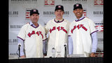 FILE - In this Jan. 23, 2019, file photo, Baseball Hall of Fame inductees Edgar Martinez, left, Mike Mussina, center, and Mariano Rivera, right, pose for photographs during news conference in New York. Baseball Hall of Fame induction ceremonies are on Sunday, July 21, 2019, in Cooperstown, N.Y. (AP Photo/Frank Franklin II)