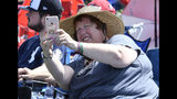 Judy Riker of Bridgewater, N.Y., takes a selfie photograph while waiting for the start of the National Baseball Hall Of Fame induction ceremony at the Clark Sports Center on Sunday, July 21, 2019, in Cooperstown, N.Y. (AP Photo/Hans Pennink)