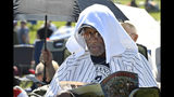 Mariano Rivera fan Eugenino Edwards, of New York uses a towel to keep cool before the National Baseball Hall of Fame induction ceremony at the Clark Sports Center on Sunday, July 21, 2019, in Cooperstown, N.Y. (AP Photo/Hans Pennink) /during an induction ceremony at the Clark Sports Center on Sunday, July 21, 2019, in Cooperstown, N.Y. (AP Photo/Hans Pennink)