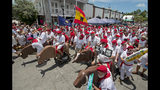"""In this photo provided by the Florida Keys News Bureau, Ernest Hemingway look-alikes begin the """"Running of the Bulls"""" Saturday, July 20, 2019, in Key West, Fla. Held on the eve of the 120th anniversary of Hemingway's birth, the whimsical takeoff on the famed run in Pamplona, Spain, was a facet of the island city's annual Hemingway Days festival that ends Sunday, July 21. Hemingway lived and wrote in Key West throughout most of the 1930s. (Andy Newman/Florida Keys News Bureau via AP)"""